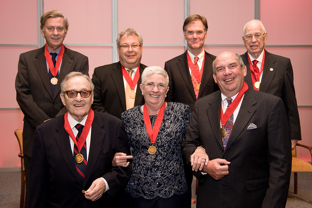 2010 Grady Fellows Front row (l-r): Edwin Pope, Carolyn Abney and Randall Abney. Back row (l-r): Phil Gailey, Steve Koonin, Bo Spalding and James H. Tate. Inducted posthumously were Joe Belew and Betty Gage Holland.