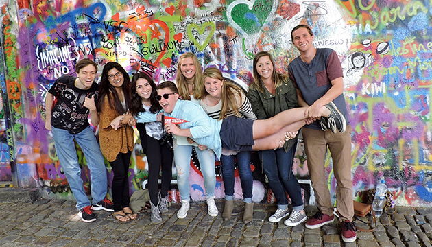 Students visit the iconic John Lennon Wall while studying Travel Journalism in Prague, Czech Republic.
