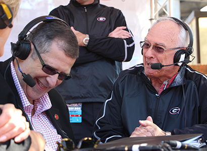 Dean Charles Davis and Loran Smith share a laugh during the tailgate show in October 2014.