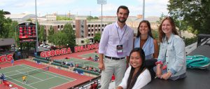 (clockwise) Instructor Carlo Finlay with students Allie Bailey, Jackie Kinney and Vira Halim at the 2017 NCAA Tennis Championships