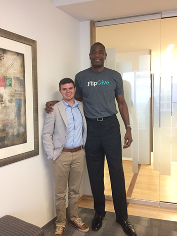 Soderstrom poses for a picture with former Atlanta Hawk Dikembe Mutombo after interviewing him about his latest business investment.