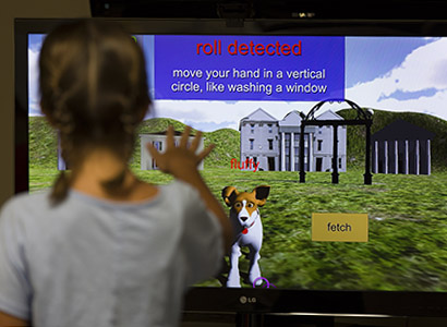 The virtual dog that children interact with does a series of tricks including fetch, roll-over and stand-up, among others.