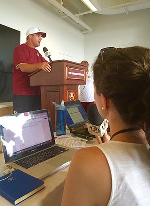 Spencer attends a press conference with Washington Redskins Head Coach Jay Gruden.