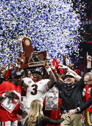 Georgia linebacker Roquan Smith (3) holds up the SEC Championship trophy with Georgia head coach Kirby Smart after winning the SEC Championship. (Photo/Reann Huber, www.reannhuber.com)