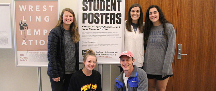 Students from Kristen Smith's Advanced Graphic Communication course view their work on display at the Special Collections Libraries.
