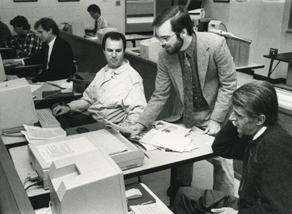 An undated picture of Barry Hollander addressing a group of international journalists.