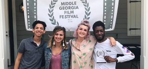 Braxton Jordan, Paige Marogil, Caitlin Guffin, and Jamaal Johnson accepted an award for Best College Story in the 2018 Middle Georgia Film Festival.