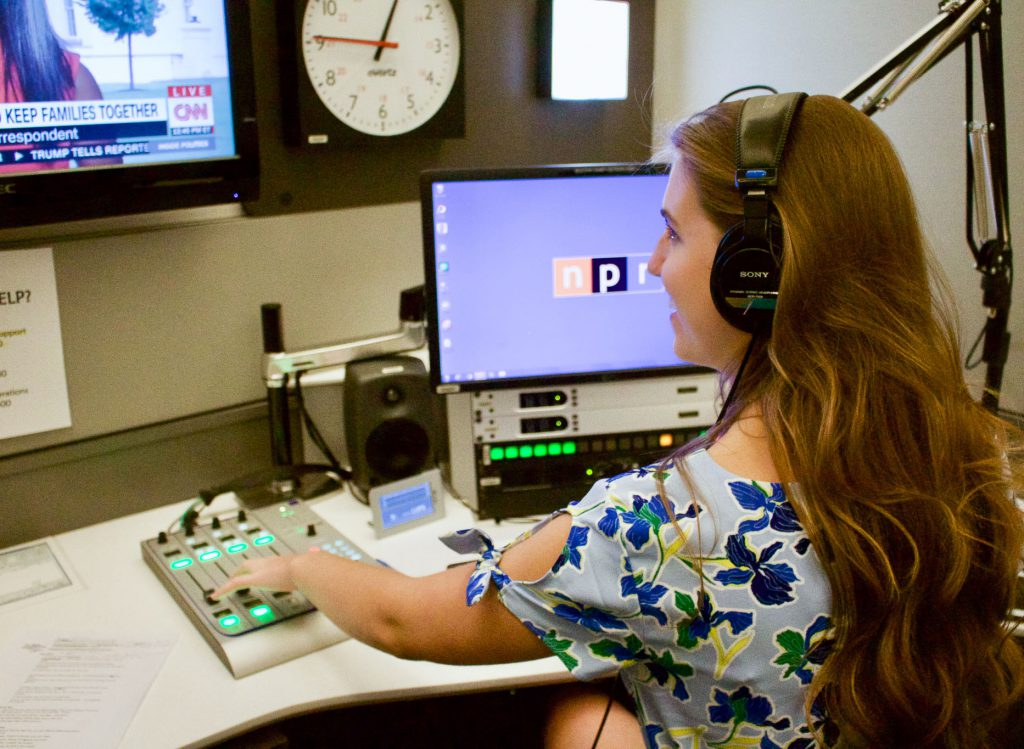 Charlotte Norsworthy operates a sound booth in NPR's newsroom. Photo: Alexis Arnold