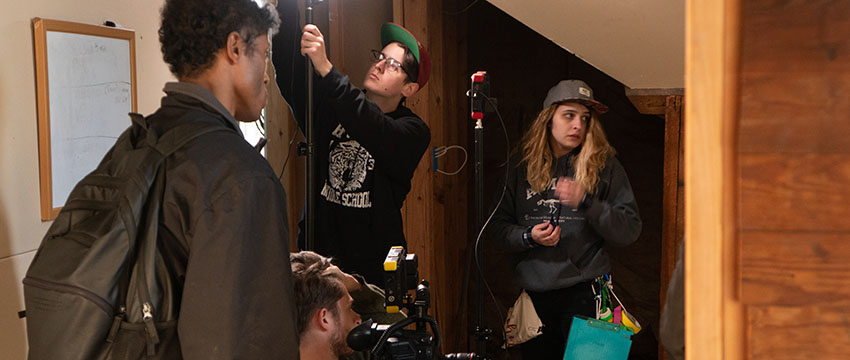 "Connor Pannell (bottom picture, behind camera), Alex Newberry (middle picture with hat) and Vivian Zingleman (far right) work together to get the scene set during the making of ""Burnt Offering."" (Photo courtesy of Connor Pannell)"