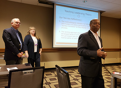Herndon and Walker watch as McCline presents during the Association of Leadership Educators conference.