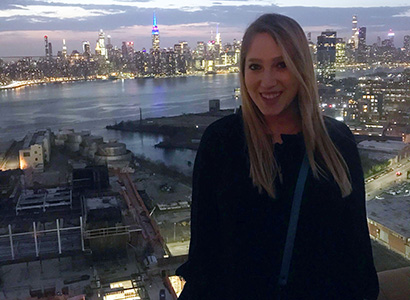 Paris enjoys a nice view of New York City after a long workday at her internship.