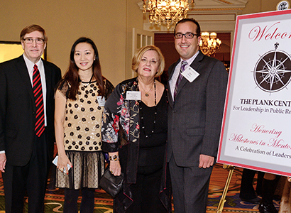 Lynne Sallot (second from right) is joined by Bryan Reber left), Juan Meng and Neil Hirsch after accepting the Milestones in Mentoring Educator Award presented by the Plank Center for Leadership in 2014.