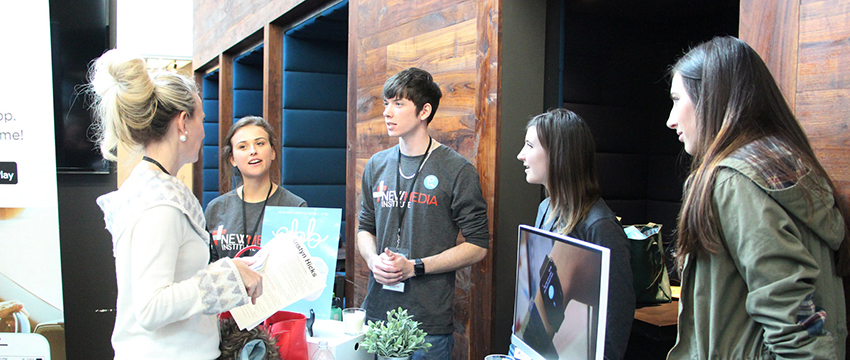 The Ebb app team describes their product to a visitor at NMI SLAM in December 2016, two months before the app launched on iTunes.