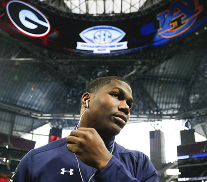 A favorite photo by Sykes. Auburn running back Kerryon Johnson (21) puts in his earbuds while walking back to the Auburn locker room after a team prayer two hours before the start of the SEC Championship game. (Photo/Casey Sykes, www.caseysykes.com)