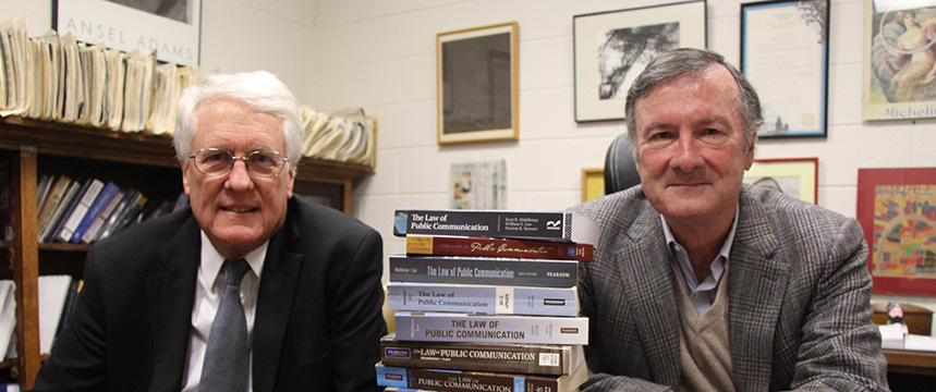 """Kent Middleton, professor emeritus of journalism, and Bill Lee, professor of journalism, celebrate the 10th edition of """"The Law of Public Communication."""" When the first edition was published in 1988, it was the first communication law text to include a chapter on """"corporate speech,"""" a chapter that has chronicled evolving First Amendment rights of corporations to spend money on paid political speech."""