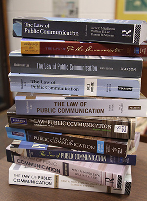 """A few of the editions of """"The Law of Public Communication"""""""