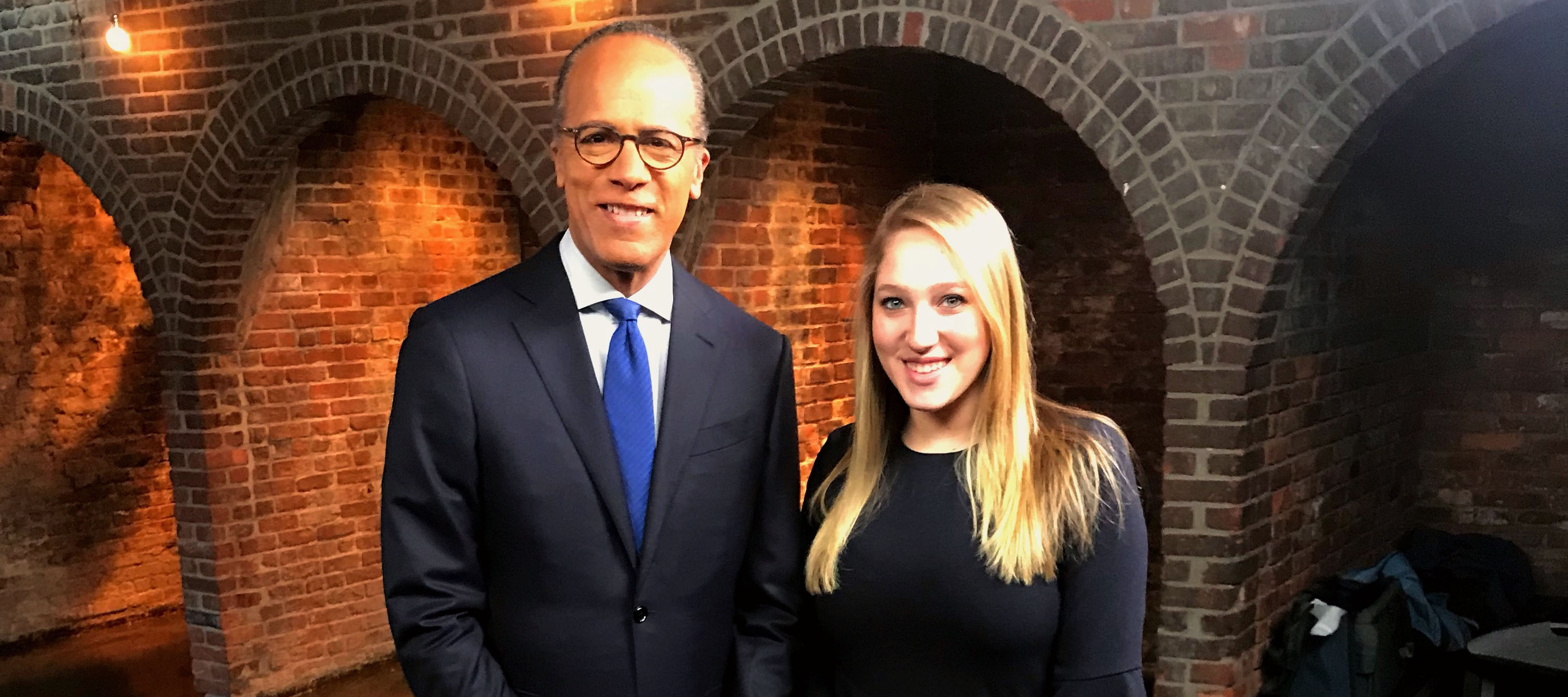 Brittany Paris standing with Lester Holt, anchor for NBC Nightly News and Dateline NBC. Paris received her first on-air credit as an assistant producer for the 'Deadly Detour' episode of Dateline (aired June 22, 2018)